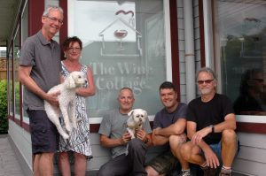 (L to R) Wine Cottage owners Lyle Brodie (with Charlie) and Pamela Brodie, with employees Claude Poirier (with Lutzy), Chad Hinsz and Nick Maud.