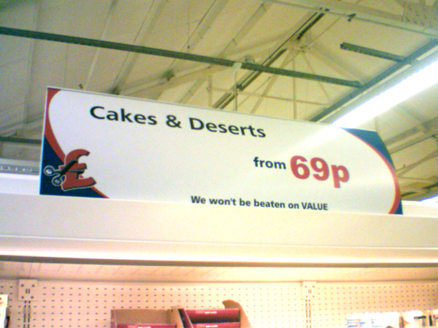 Tesco Sign Spelling Deserts
